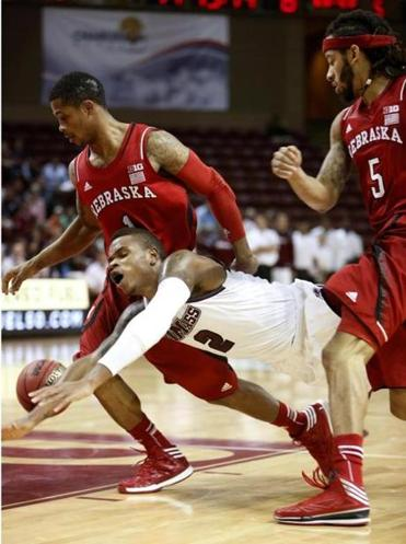 UMass forward Maxie Esho (13 points, six rebounds) gets tripped up by Nebraska's defense in the first half.